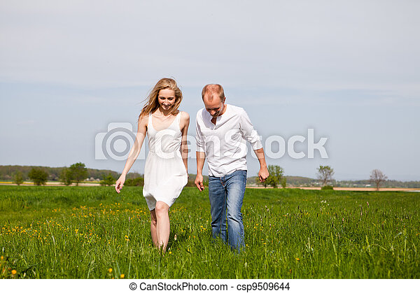 young happy couple have fun in summer - csp9509644