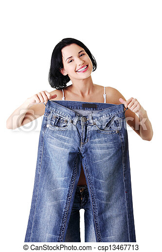 Young happy fit woman with big pants - csp13467713