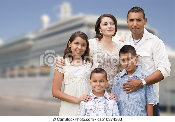 Young Happy Hispanic Family In Front of Cruise Ship - csp18374383