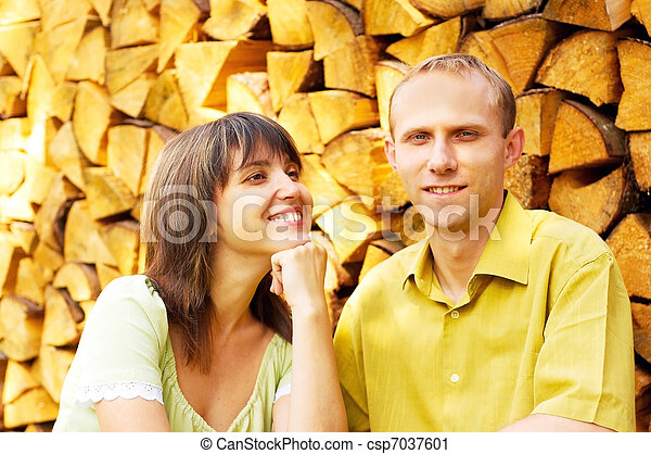 Young happy smiling attractive couple together outdoors - csp7037601