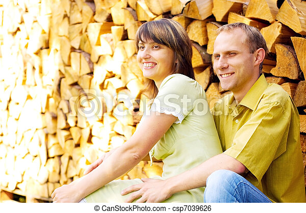 Young happy smiling attractive couple together outdoors - csp7039626