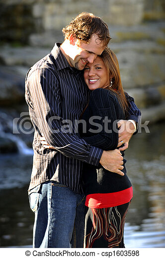 Young Happy Smiling Attractive Interracial Couple Outdoors - csp1603598