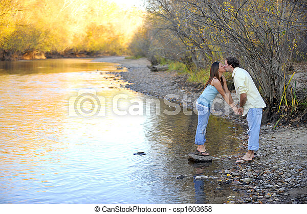 Young Happy Smiling Attractive Interracial Couple Outdoors - csp1603658