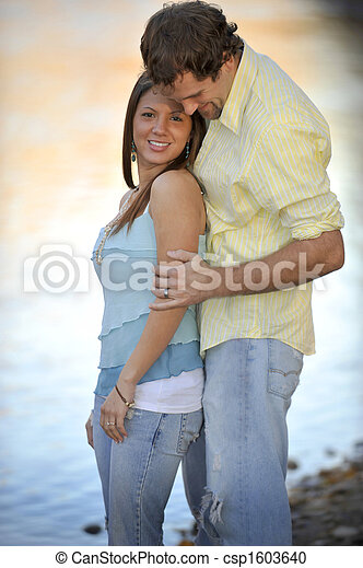 Young Happy Smiling Attractive Interracial Couple Outdoors - csp1603640