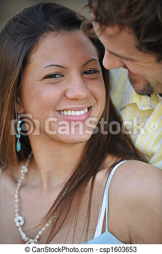 Young Happy Smiling Attractive Interracial Couple Outdoors - csp1603653