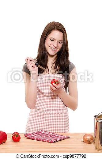young happy woman about to cutting tomatoes on white background - csp9877792
