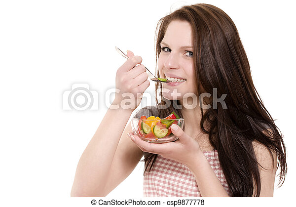 young happy woman eating paprika salad on white background - csp9877778