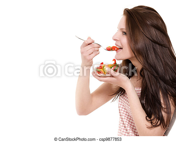 young happy woman eating salad on white background - csp9877853