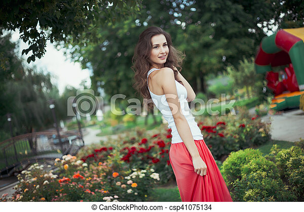 young happy woman in the park - csp41075134