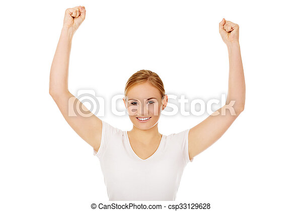 Young happy woman with arms up - csp33129628