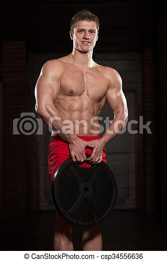 Young Healthy Man Working Out With Weights - csp34556636