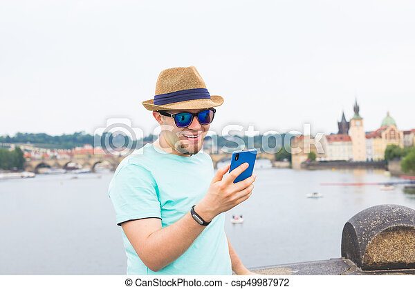 Young hipster man using mobile smart phone outdoor - csp49987972