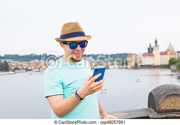 Young hipster man using mobile smart phone outdoor - csp49257661