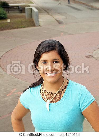 Young hispanic teen girl smiling outdoor portrait - csp1240114