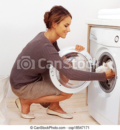 young housewife doing laundry - csp18547171
