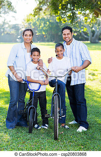 young indian family of four - csp20803868