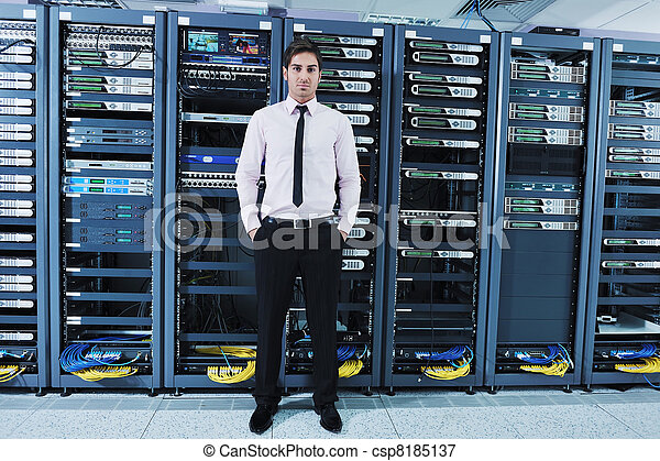 Young it engineer in data center server room. Young handsome ...