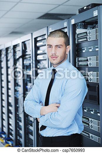 young it engineer in datacenter server room - csp7650993
