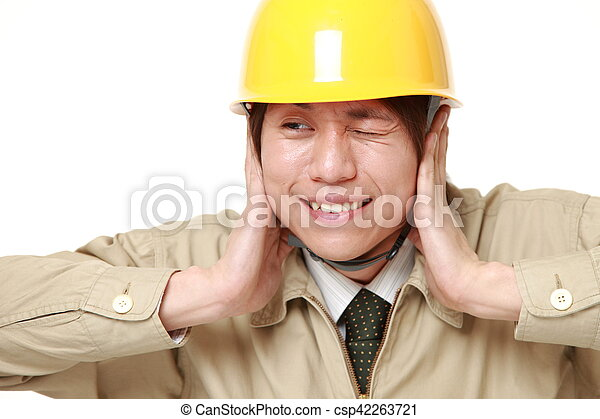Young Japanese construction worker suffers from noise - csp42263721
