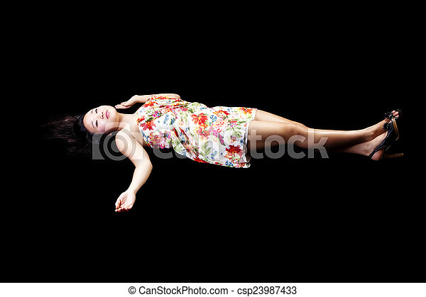 Young Japanese Woman Reclining In Dress Black Background - csp23987433