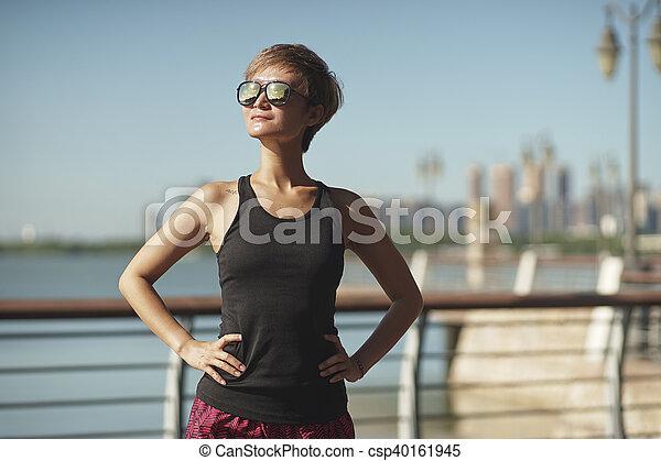 young jogger take a break during jogging in city park. Black Bedroom Furniture Sets. Home Design Ideas