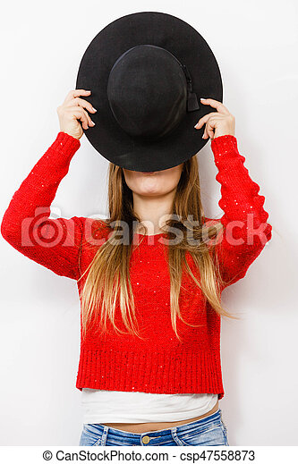 facda950713 Fashion elegant clothing fun gesture concept. young lady hiding her face.  yothful blonde girl covering herself with hat.