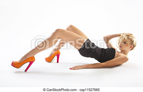 Young lady wearing orange high-heels - csp11527665