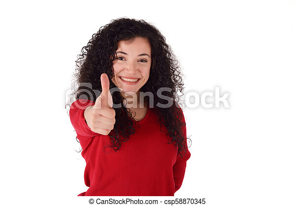 young latin woman giving thumbs up. - csp58870345