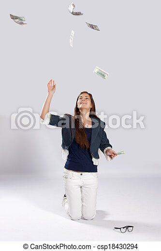 Young long-haired woman throw money - csp18430294