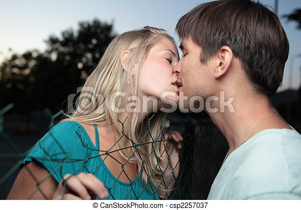 young lovely couple kissing lovingly