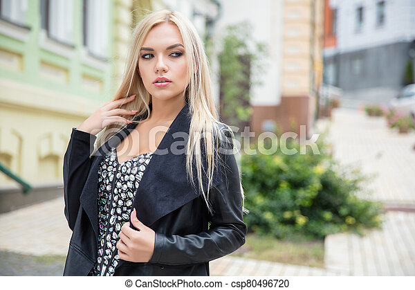 Young lovely woman posing on the street - csp80496720