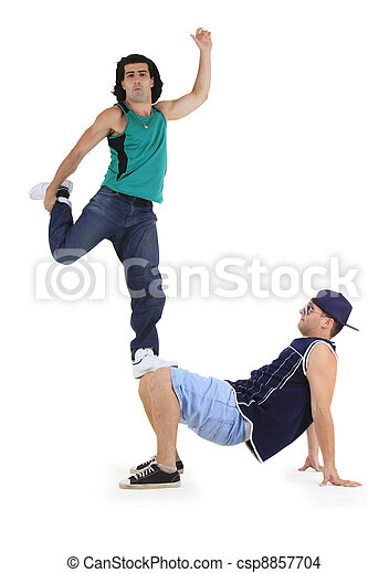 young male dancers performing a bboying stunt - csp8857704