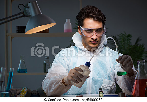 Young male lab chemist late at night in overtime time pictures ...