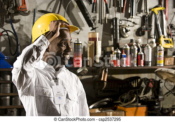 Young male office worker in repair shop - csp2537295