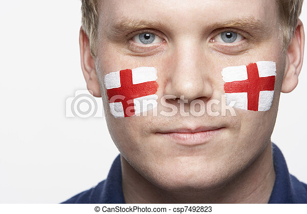 Young Male Sports Fan With St Georges Flag Painted On Face - csp7492823