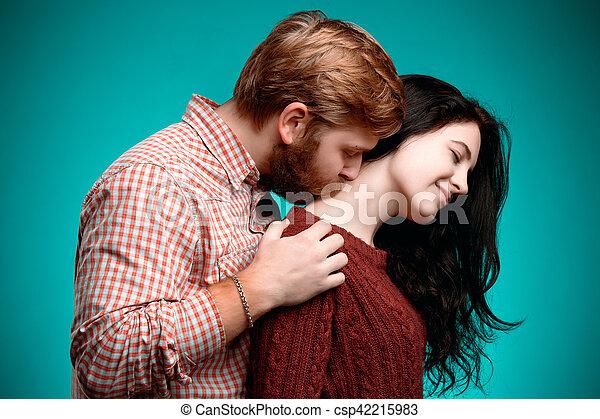 Young man and woman kissing - csp42215983