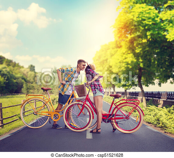 Young man and woman, romantic date on bicycles - csp51521628