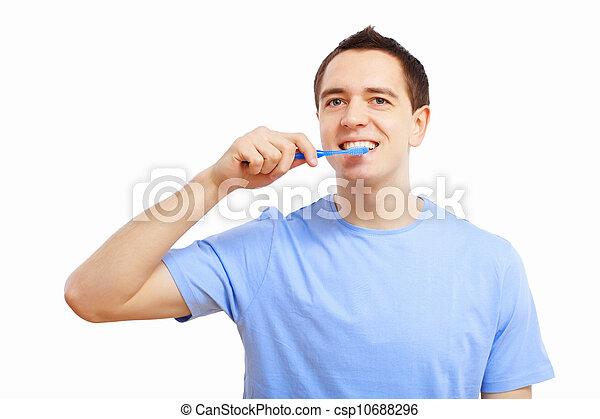 Young man at home brushing teeth - csp10688296