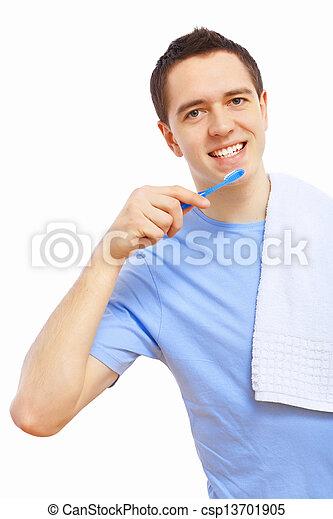 Young man at home brushing teeth - csp13701905