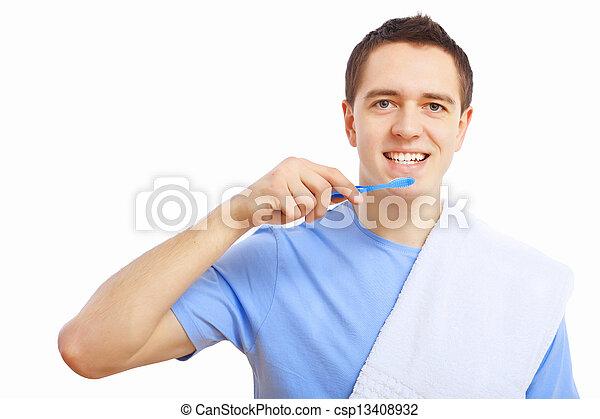 Young man at home brushing teeth - csp13408932