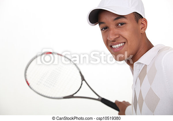 Young man dressed for tennis - csp10519380