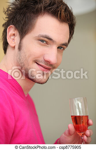 young man drinking wine - csp8775905