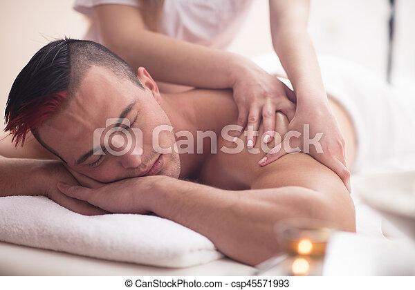 young man having a back massage - csp45571993