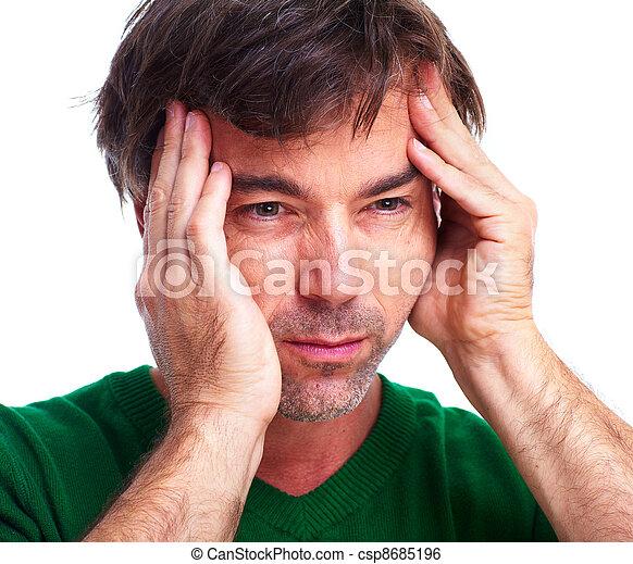 Young man having a headache. - csp8685196