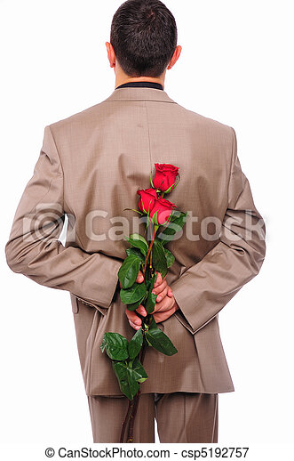 young man hides behind a rose - csp5192757