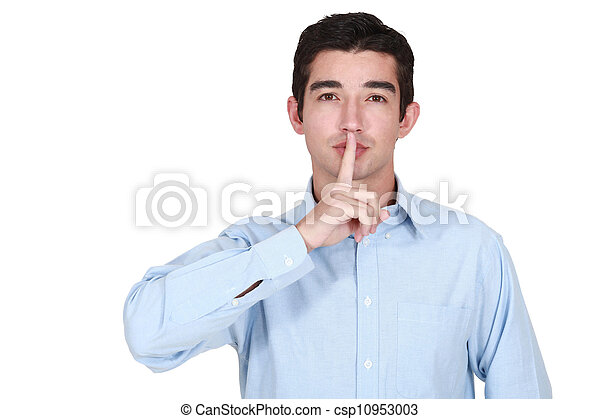 young man holds finger before lips - csp10953003