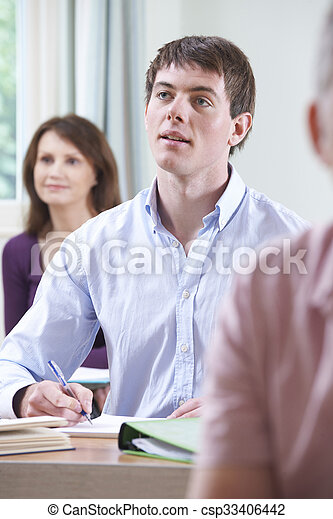 Young Man In Adult Education Class - csp33406442