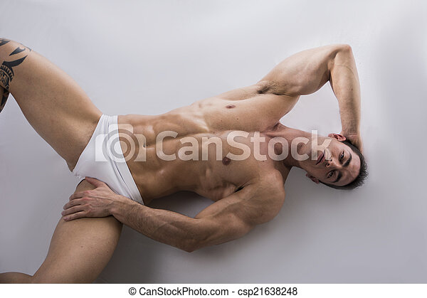 guy laying in bed naked