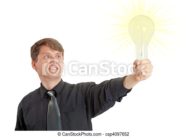 Young man lit by bright idea in form of electric light - csp4097652