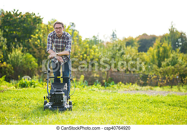 Young man mowing the grass - csp40764920